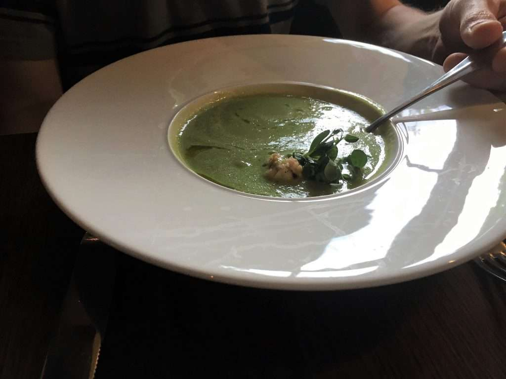 Pea soup in a large, deep bowl