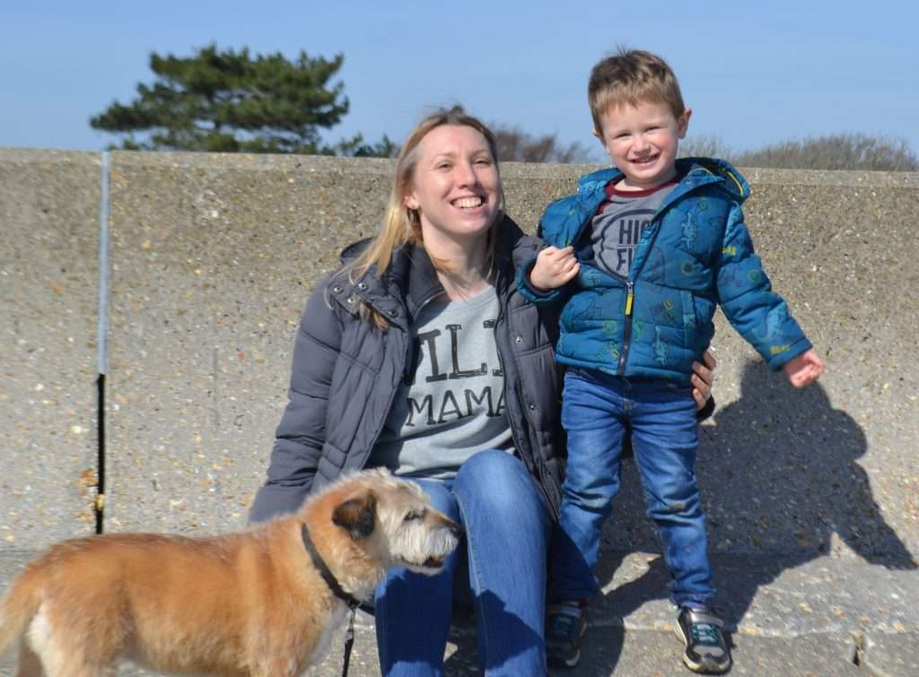 Emma Reed, her son and her border terrier.