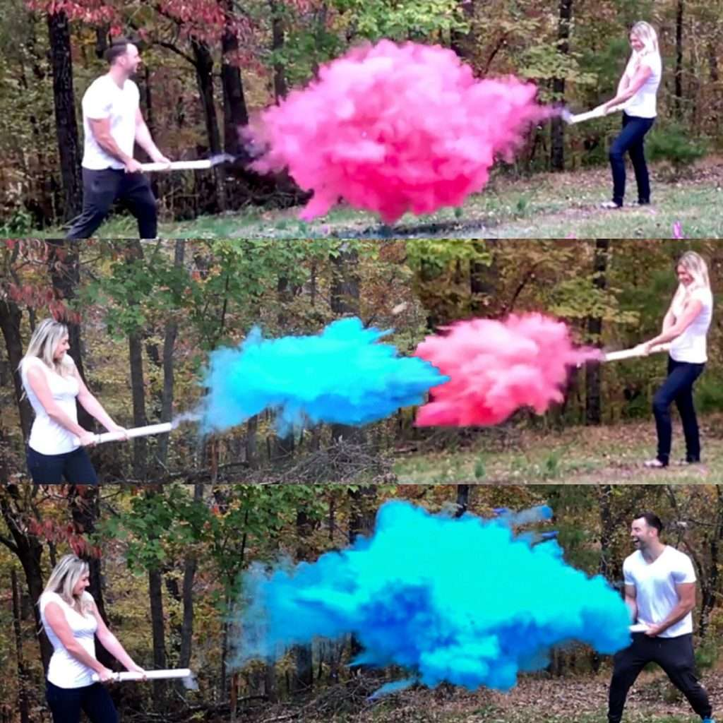 Couple squirting pink and blue powder cannons at each other