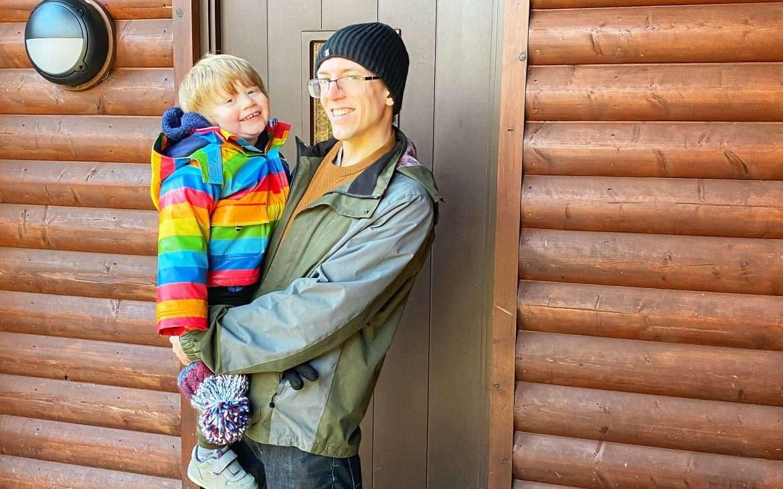 My toddler and husband outside Skomer Lodge