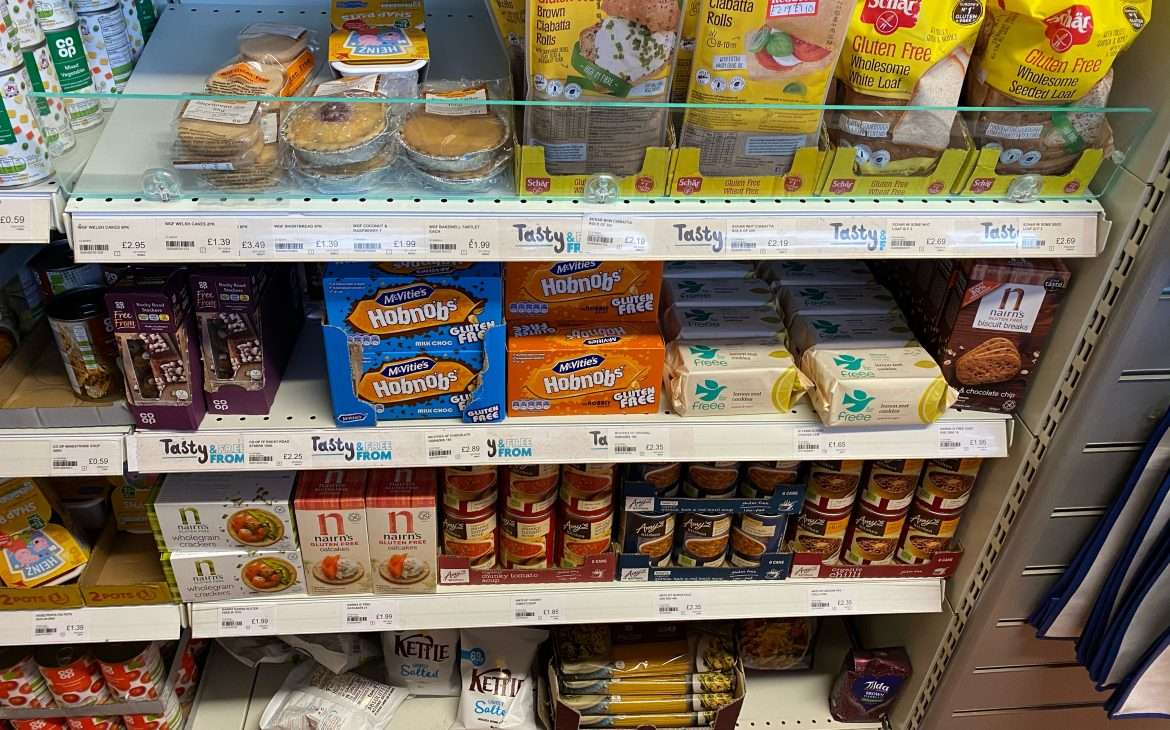 Gluten free products on the shelves of a shop.